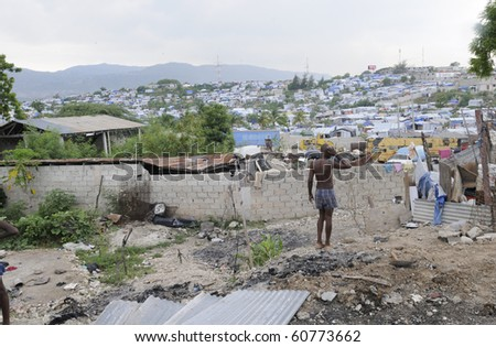 PORT-AU-PRINCE - AUGUST 28:  A puzzled man thinking about his Tent ,that was destroyed due to fire, on August 28, 2010 in Port-Au-Prince, Haiti - stock photo