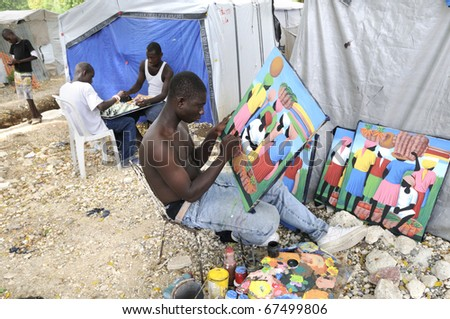 PORT-AU-PRINCE - AUGUST 31:  An artist painting images and on the background  kids playing chess- a typical example of Social contrast, in Port-Au-Prince, Haiti on August 31, 2010. - stock photo