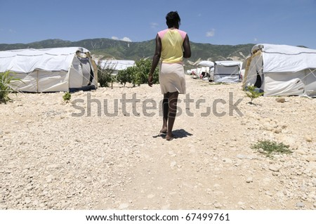 PORT-AU-PRINCE - AUGUST 30:  An Haitian girl walking towards her tent in one of the tent city  in Port-Au-Prince, Haiti on August 30, 2010. - stock photo