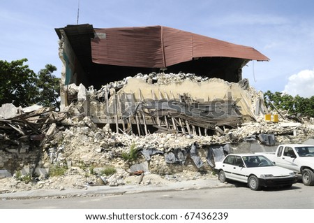 PORT-AU-PRINCE - AUGUST 26: Back side of the collapsed Presidential Building  which remains the way it was 7 months before, in Port-Au-Prince, Haiti on August 26, 2010. - stock photo