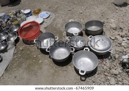 PORT-AU-PRINCE - AUGUST 25 : Empty cooking utensils in Cite Soleil-where majority of the population lies below poverty level,  in Port-Au-Prince, Haiti on August 25, 2010. - stock photo