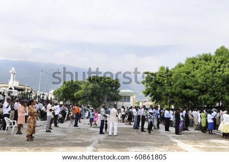 PORT-AU-PRINCE - AUGUST 22: People gathered in the churchyard of a broken church for prayer, in Port-Au-Prince, Haiti on August 22, 2010.