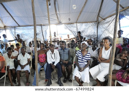 PORT-AU-PRINCE - AUGUST 31:Residents gathered in a meeting to decide on the future action regarding the alleged atrocities of the NGO's in Port-Au-Prince, Haiti on August 31, 2010. - stock photo