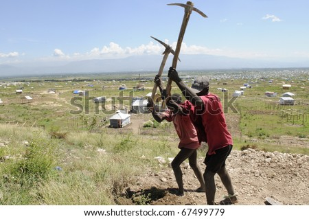 PORT-AU-PRINCE - AUGUST 30:   Residents working on top of a hill to migrate their tent  from another part of the city ,in Port-Au-Prince, Haiti on August 30, 2010. - stock photo