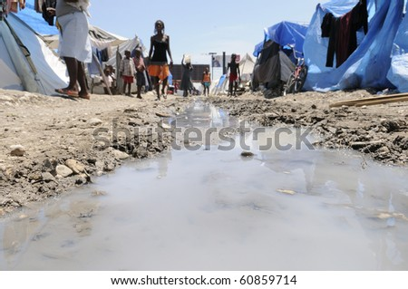 PORT-AU-PRINCE - AUGUST 28:  Stagnant waters can be found all around the tent cities, a breeding place for all possible germs,  in Port-Au-Prince, Haiti on August 28, 2010. - stock photo