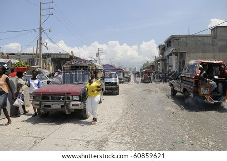 "PORT-AU-PRINCE - AUGUST 27: ""Tap-Tap"" are the most common and cheapest way of transportation in Haiti,.  in Port-Au-Prince, Haiti on August 27, 2010"