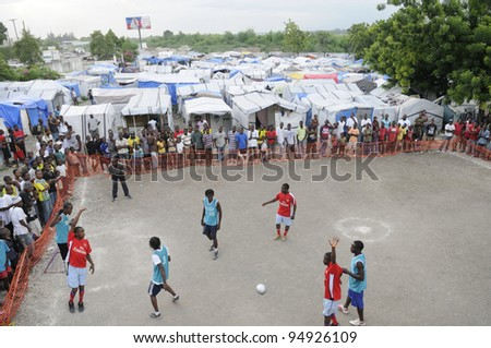 PORT-AU-PRINCE - AUGUST 26:  Teams playing a  friendly soccer match in one of the tent cities in Port-Au-Prince, Haiti on August 26, 2010.