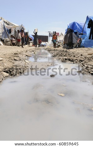 PORT-AU-PRINCE - AUGUST 28:   The tent cities are devoid of any proper sanitation and sewerage system,  in Port-Au-Prince, Haiti on August 28, 2010. - stock photo