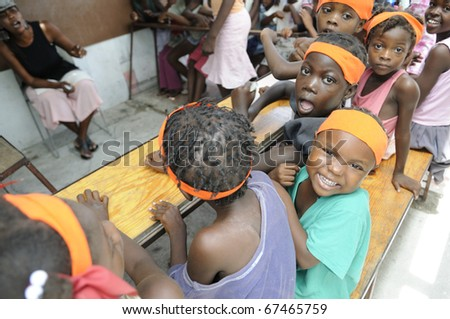 PORT-AU-PRINCE - AUGUST 25:  unidentified Haitian children of  a small school in Cite Soleil- one of the poorest area in the western hemisphere , in Port-Au-Prince, Haiti on August 25, 2010. - stock photo
