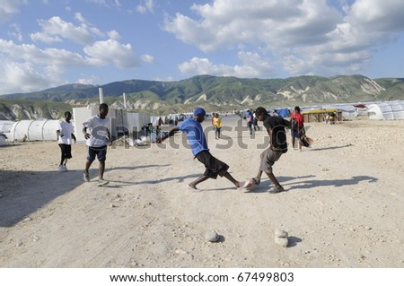 PORT-AU-PRINCE - AUGUST 30:  Young adults playing soccer, in Port-Au-Prince, Haiti on August 30, 2010. - stock photo
