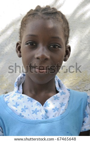 PORT-AU-PRINCE - SEPTEMBER 2: An unidentified Haitian young adult  girl posing for the camera during a camp  in Port-Au-Prince, Haiti on September 2, 2010. - stock photo