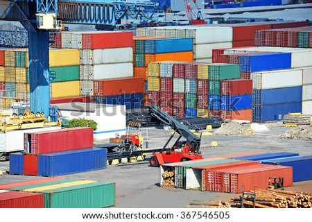Port cargo crane and container over blue sea background - stock photo