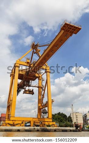 Port cargo crane in harbor - stock photo