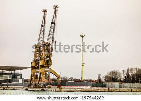 Port cargo crane over sky background in Venice - stock photo