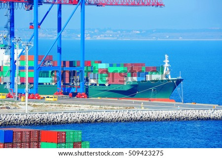 Port cargo crane, ship and container over blue sky background