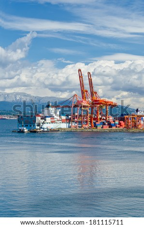 Port Container Terminal in Vancouver, Canada.  Vertical. - stock photo