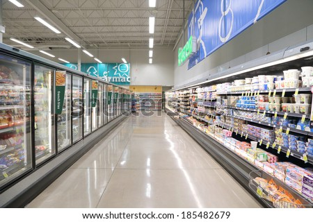 Port Coquitlam BC Canada - July 25, 2013 : Dairy and fozen food corridor in PriceSmart Foods. It is a regional chain of supermarkets located in British Columbia, Canada. - stock photo