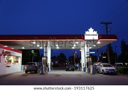 Port Coquitlam BC Canada - May 10, 2014 : One side of Petro Canada gas station on May 10, 2014. The company retained the Suncor Energy name for the merged corporation and its upstream operations. - stock photo
