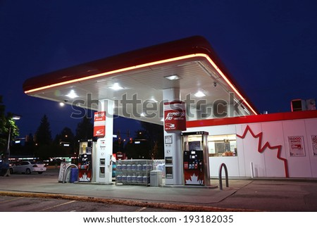 PORT COQUITLAM, CANADA - MAY 10, 2014 : One side of Petro Canada gas station on May 10, 2014. The company retained the Suncor Energy name for the merged corporation and its upstream operations.