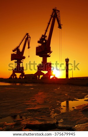 Port crane for work in the sunset