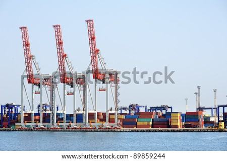 port cranes and container warehouse - stock photo