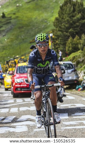 PORT DE PAILHERES,FRANCE- JUL 6:The Colombian cyclist Nairo Alexander Quintana Rojas from Movistar Team climbing the road to Col de Pailheres during the stage 8 of the Le Tour de France on 6 July 2013 - stock photo