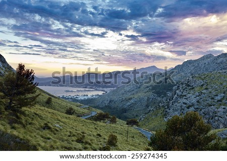 Port de Pollenca at dusk - northern Majorca. View from the serpentine road on the way to the Cap Formentor. Majorca is the largest island in the Balearic Islands archipelago in Spain. - stock photo
