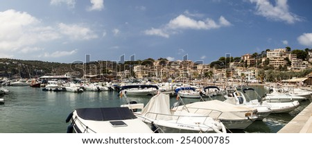 PORT DE SOLLER, MAJORCA, SPAIN - AUGUST 6, 2014: Harbor view in Port de Soller  Mallorca with boats and buildings on August 6, 2014 in  Port de Soller, Majorca, Spain. - stock photo