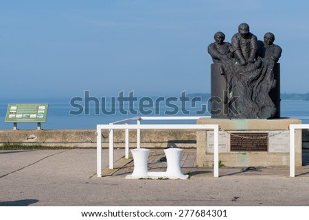 PORT DOVER-MAY 10: Fishermen Monument on May 10, 2015 in Port Dover, Ontario. The sculpture is dedicated to commercial fishermen who lost their lives on Lake Erie and is located near the lighthouse - stock photo