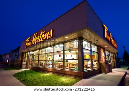 PORT ELGIN, ONTARIO - JULY 17, 2013: A wide angle view of a Tim Hortons coffee shop at night. - stock photo