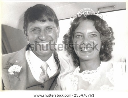 PORT ELIZABETH, SOUTH AFRICA - 1970's: The newly wed couple in their wedding car - stock photo