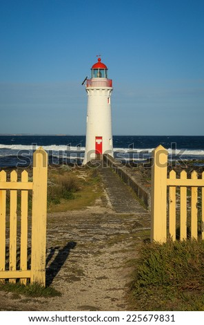 Port Fairy lighthouse (c1859) on Griffiths Island in Victoria, Australia in late afternoon light. - stock photo