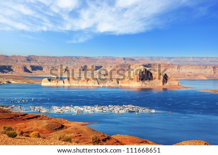 Port for white yachts on Lake Powell. Spectacular sunset - stock photo