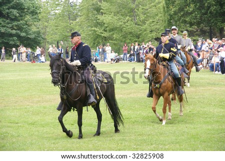 PORT GAMBLE, WA - JUN 20: Civil War reenactors participate in a mock battle. Union and Confederate cavalry maneuvering in open field.