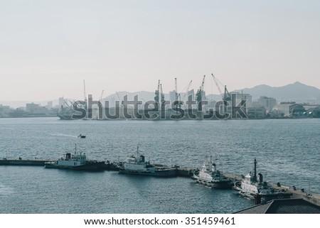 Port Harbor Of Kobe With Crane Dock Logistic Hub at noon - stock photo