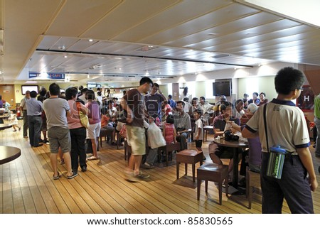 PORT KLANG, MALAYSIA - OCTOBER 1:Visitors at the MV Logos Hope cafe on October 1, 2011 in Port Klang, Malaysia. The 132.5m long ship host the world's biggest floating book fair with 5000 book title. - stock photo