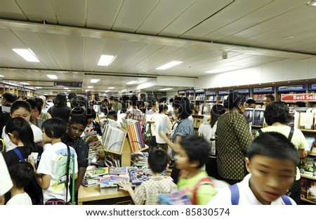 PORT KLANG, MALAYSIA - OCTOBER 1:Visitors in the MV Logos Hope book fair on October 1, 2011 in Port Klang, Malaysia. The 132.5m long ship host the world's biggest floating book fair with 5000 title. - stock photo
