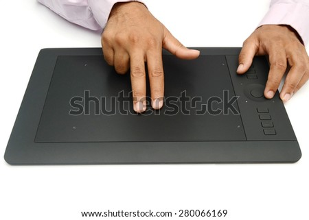 Port-Louis, Mauritius - May 20, 2015 User using Wacom Intuos pro with hand gesture. Intuos is a product of Wacom a Japanese company specialized in graphics tablets and related products