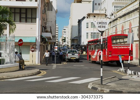 PORT LOUIS, MAURITIUS - NOVEMBER 29, 2012: View to the street with pedestrian crossing in downtown Port Louis, Mauritius.   - stock photo