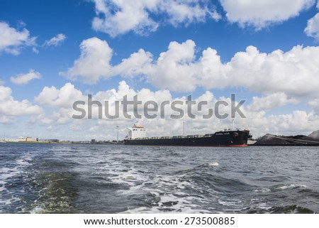 Port of Amsterdam, Noord-Holland/Netherlands - April 28-04-2015 - Bulk carrier Global Star is moored in the westhaven and started cargo operations at the OBA terminal. Cloudy sky at the background. - stock photo