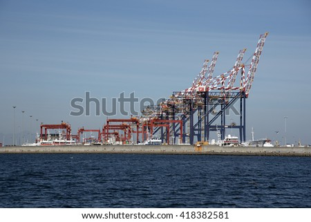 PORT OF CAPE TOWN SOUTH AFRICA - APRIL 2016 - The container port gantrys seen from across the seawall of the port
