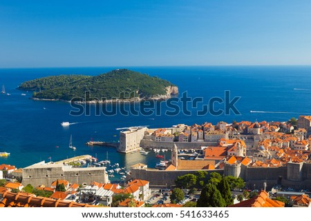 Port of Dubrovnik and red roofs from the old town walls, Lokrum island behind, Croatia