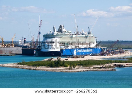 PORT OF FREEPORT GRAND BAHAMAS ISLAND - JAN., 18, 2015: Royal Carribeans Freedom Of The Seas in a floating drydock  - stock photo