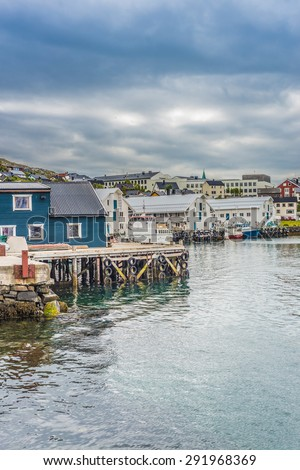 Port of Honningsvag, where all the cruise ships in the summer months stops in Finmark, Norway. - stock photo