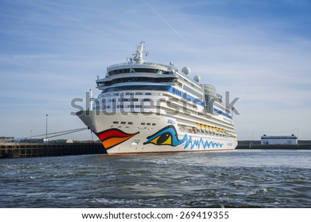 Port of IJmuiden, Noord-Holland/Netherlands - April 13-04-15 - The Cruise ship Aidaluna is moored at quay. Passengers an board and enjoying there holiday.   - stock photo