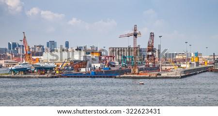 Port of Naples, coastal cityscape with shipyard dock - stock photo