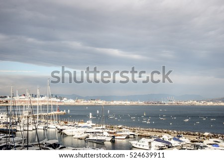 Port of Naples, Italy in Europe with ships and boats. cloudy weather.