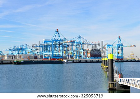 PORT OF ROTTERDAM, NETHERLANDS -September  29, 2015: Fully  computer  controlled  container terminal  From  APM  terminals  at work in the port of Rotterdam