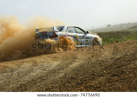 PORT OF SPAIN - APRIL 2: Action during the Trinidad and Tobago 2011 Motor Car Rally meet April 2, 2011 in Cipero, Trinidad & Tobago.  It is the largest motor sport event in the country. - stock photo