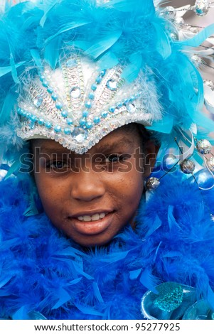 PORT OF SPAIN - FEBRUARY 11: Makela Edwards portraying Splash during the Red Cross Children's Carnival celebrations on February 11, 2012 in Port Of Spain, Trinidad & Tobago. - stock photo